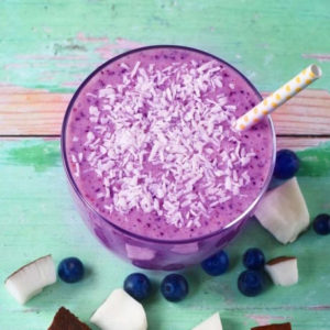 Blueberry and Coconut Smoothie on a green wooden surface