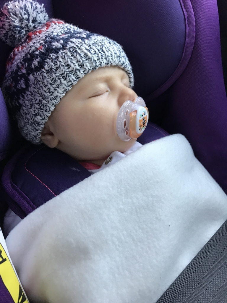 Avery asleep in car seat