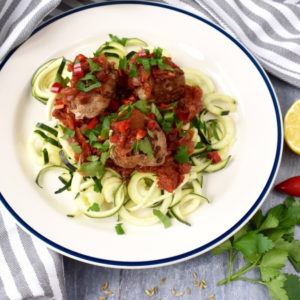 Pork and Fennel Meatballs with Courgetti on a whit plate