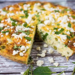 Courgette, Mint and Feta Frittata with a slice cut out of it