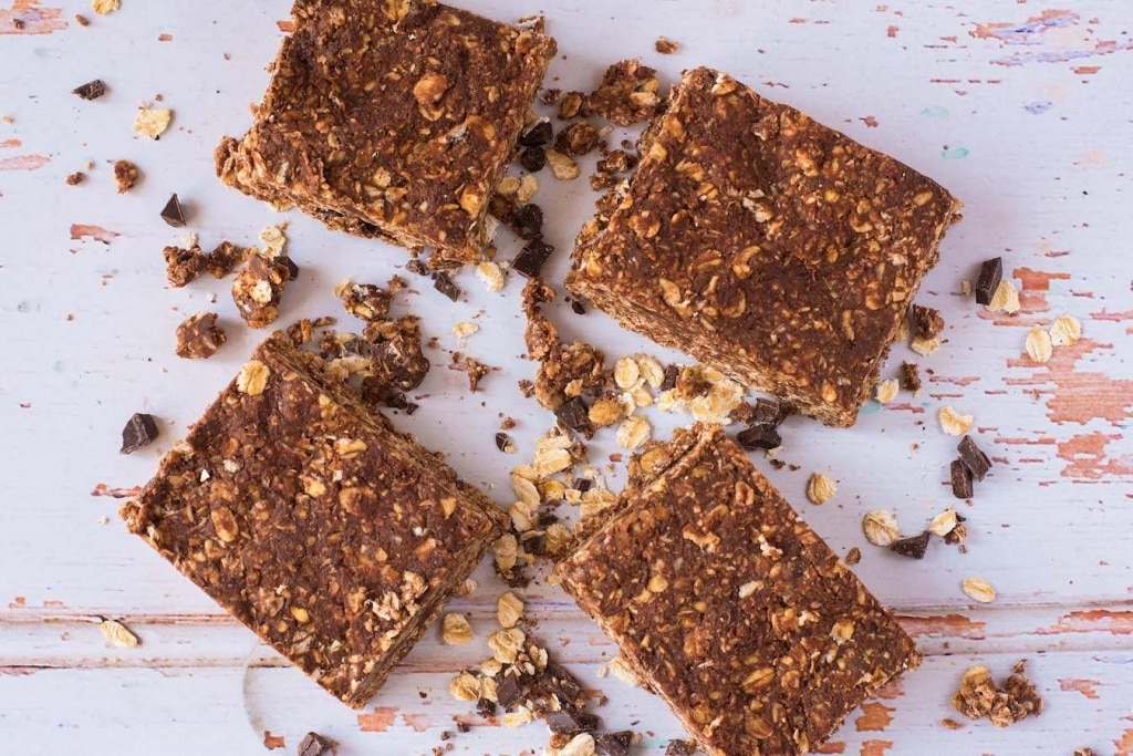 No-Bake Chocolate Peanut Butter Oat Squares on a wooden surfave