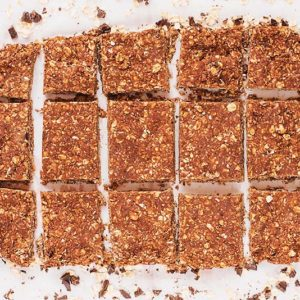 A slab of chocolate and peanut butter oats cut into squares