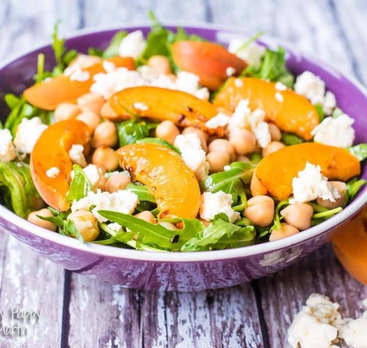 Apricot, Chickpea and Feta Salad in a purple bowl on a wooden surface