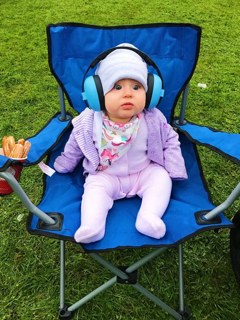 Avery sat in a camping chair wearing a pair of ear defenders