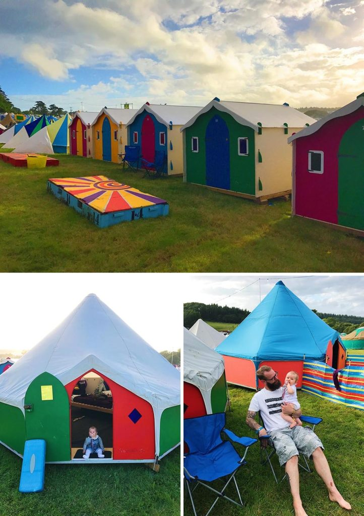 A row of colourful little chalets used for camping at Camp Bestival