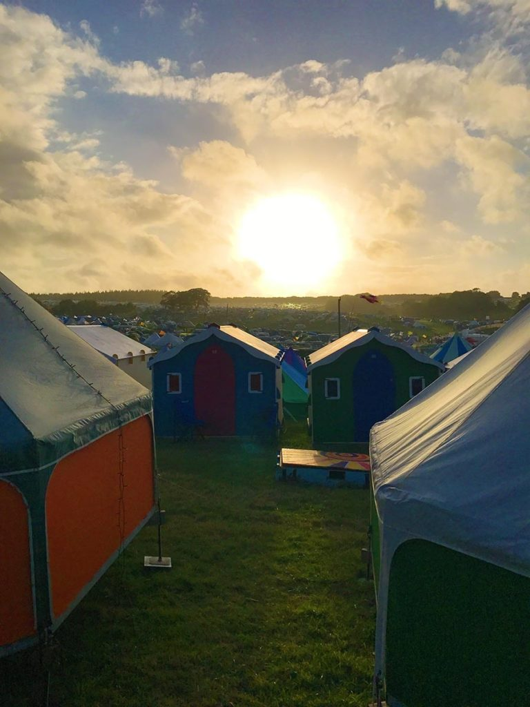 The sun setting over Camp Bestival's Boutique Camping area