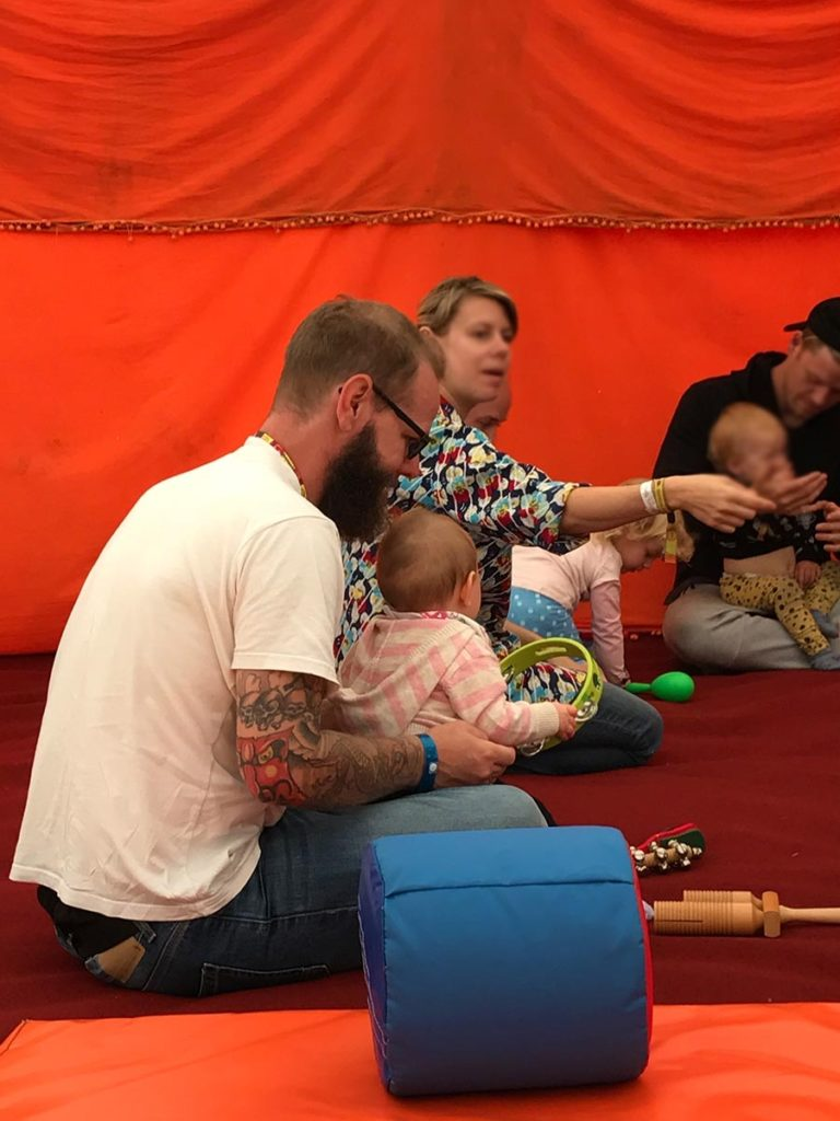 Dave and Avery enjoying music time in a soft play area