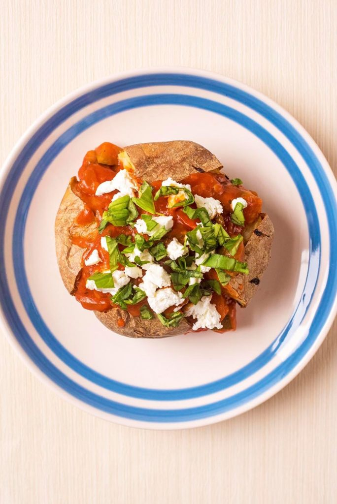 Jacket Potato topped with Ratatouille & Goat's Cheese