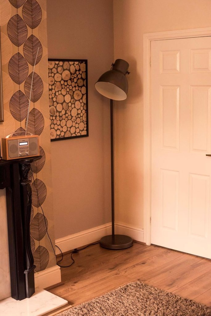 Angled shot of alcove with picture and lamp