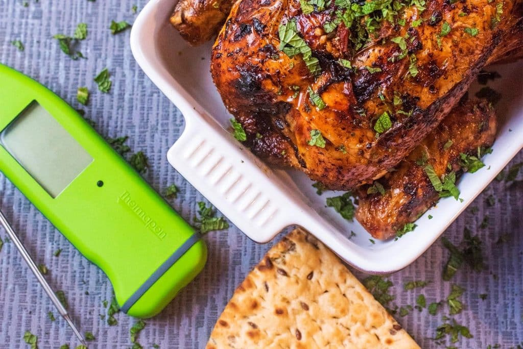 Landscape shot of Harissa Roasted Chicken with thermapen