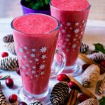 Cranberry Smoothie in a tall glass decorated with stars.