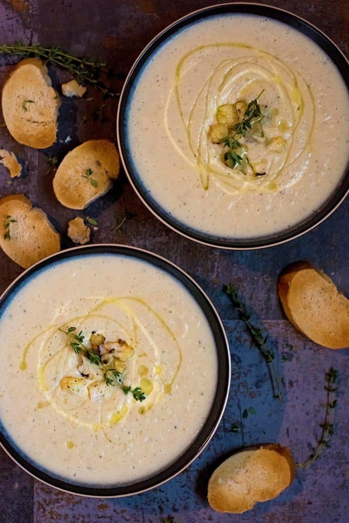 Two bowls of Creamy Roasted Cauliflower Soup
