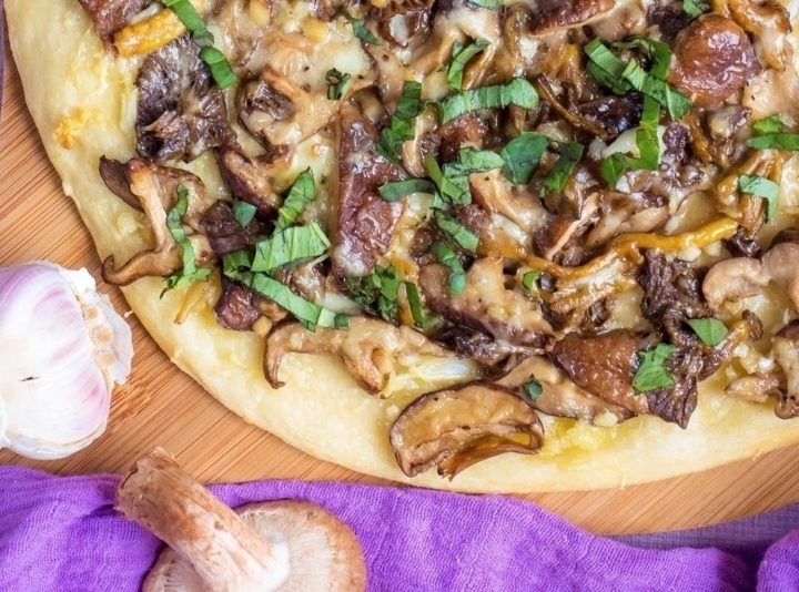 Garlic Mushroom Pizza on a wooden serving board
