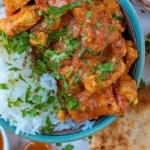 Tomato and Garlic chicken curry in a blue bowl