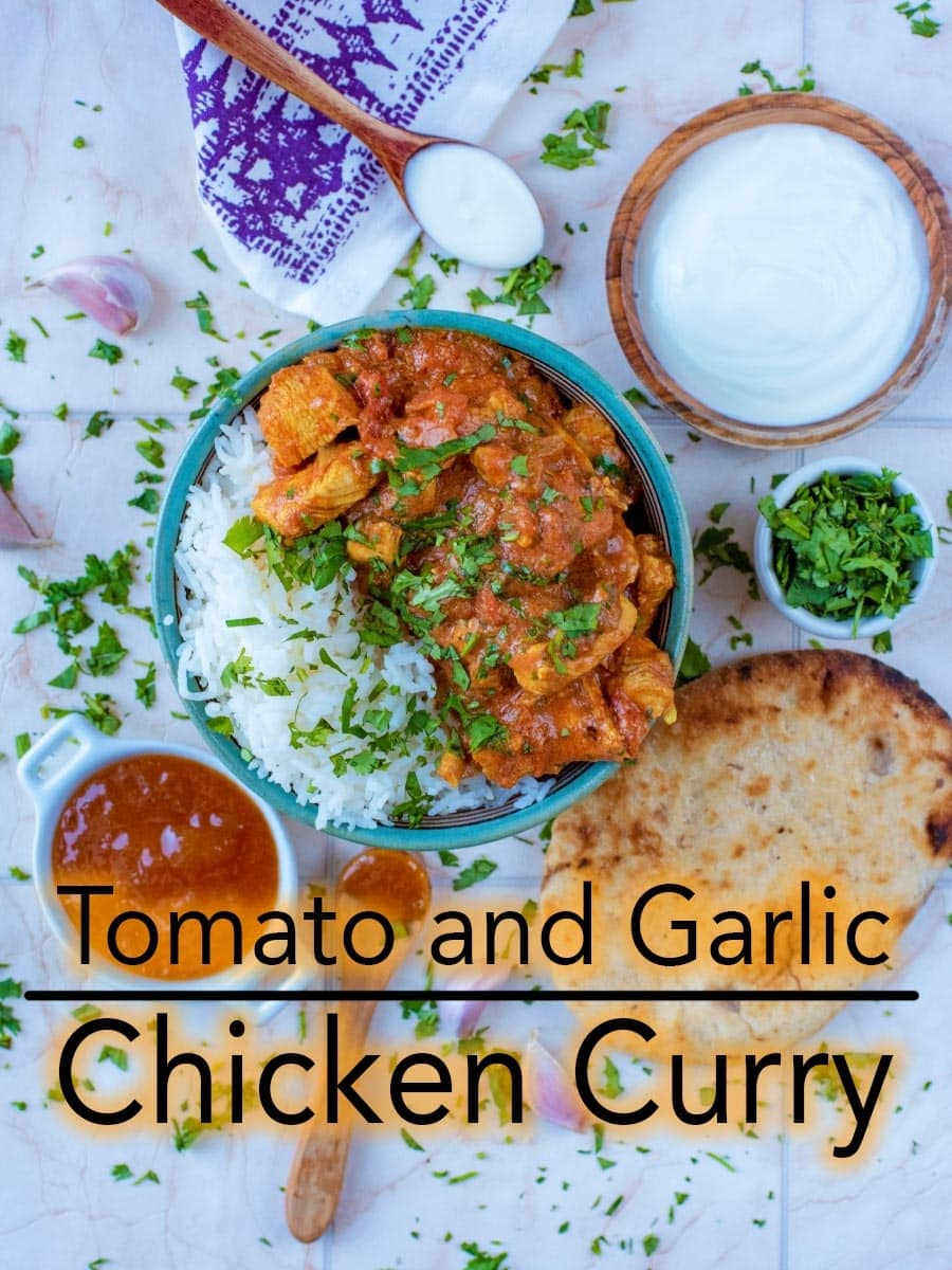 If you're looking for a quick curry recipe but don't like spicy food, give this Tomato and Garlic Chicken Curry a try. It's a rich and creamy curry with just a tiny bit of spice, which could easily be left out to make a lovely mild chicken curry. #chickencurry #curry #indian #indianfood #curryrecipe