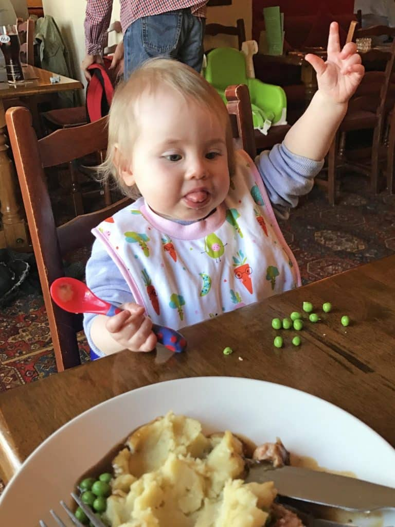 Avery eating peas