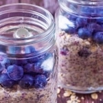 Blueberry Muffin Overnight Oats in two mason jars topped with blueberries