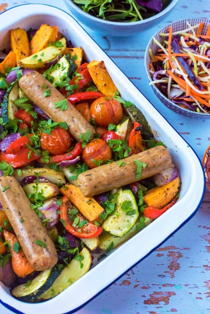 Sausage and vegetable traybake in a white dish