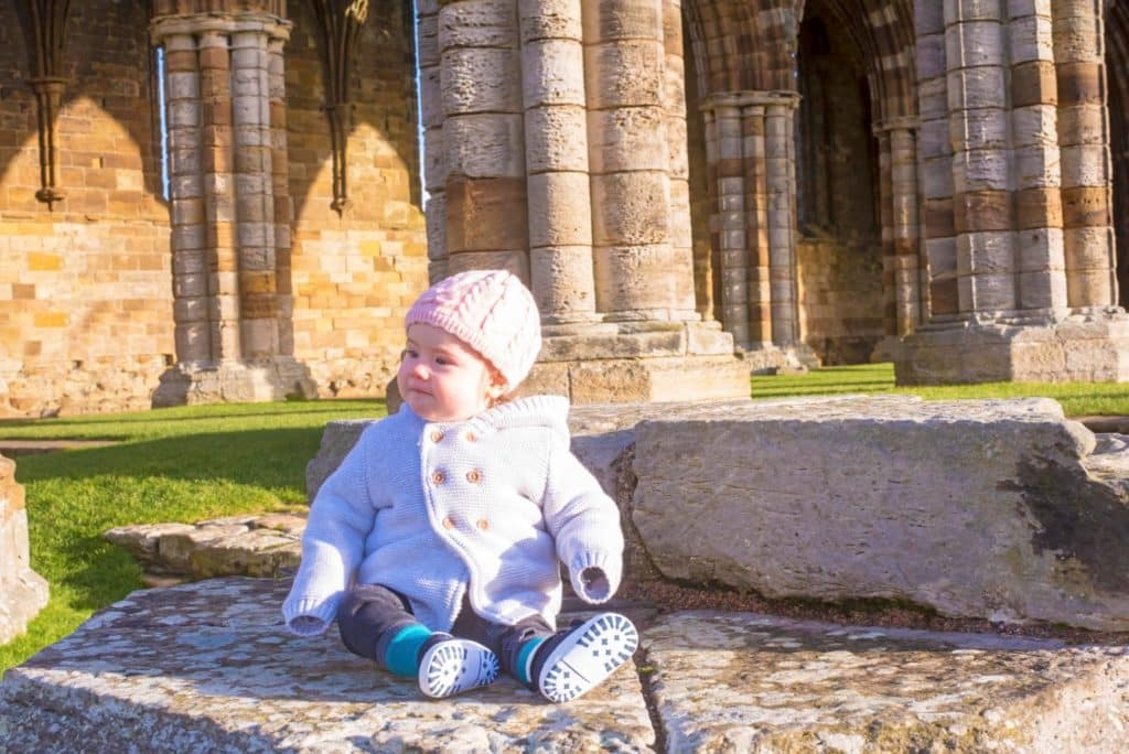 Avery sitting in Whitby Abbey