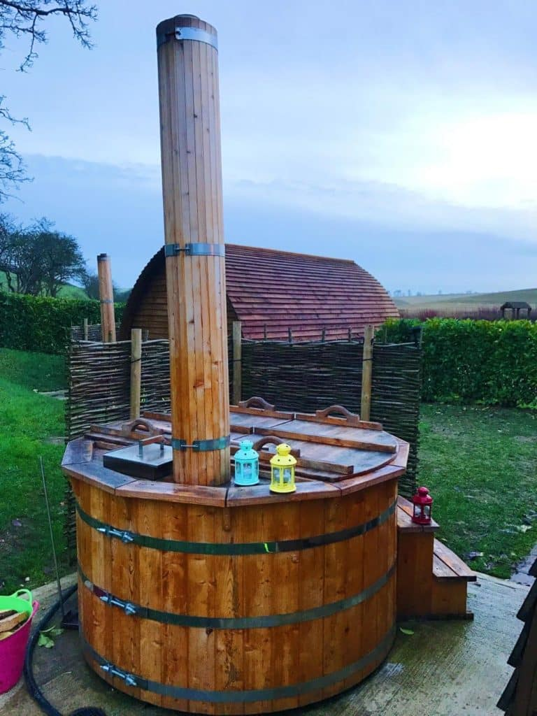 The wooden hot tub outside the wigwam