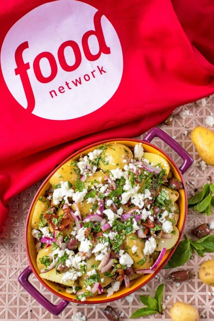 Mediterranean Potato Salad with Food Network apron top down