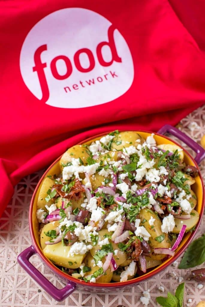 Mediterranean Potato Salad with food network apron angled