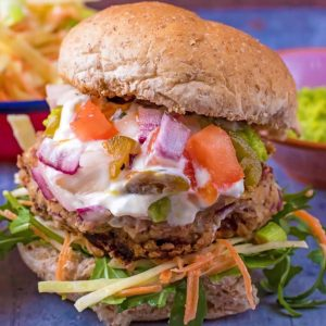 Mexican bean burger in a bun with salad, slaw, salsa and sauce