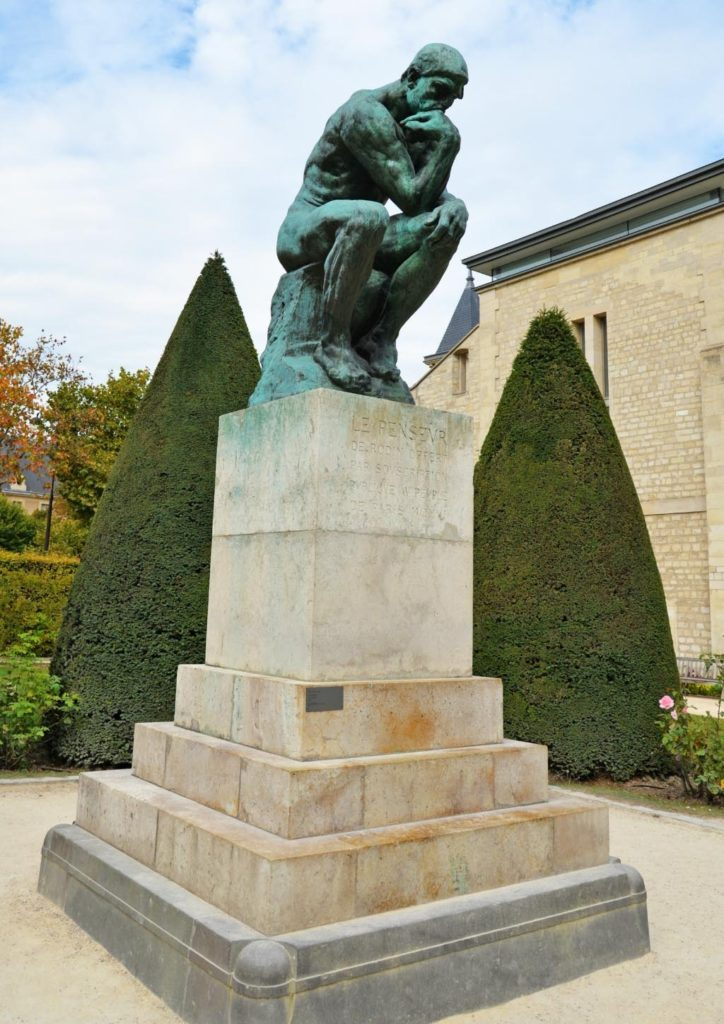 Auguste Rodin's The Thinker on a large stone pillar