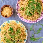 Two plates of Creamy Butternut Squash Hummus Pasta