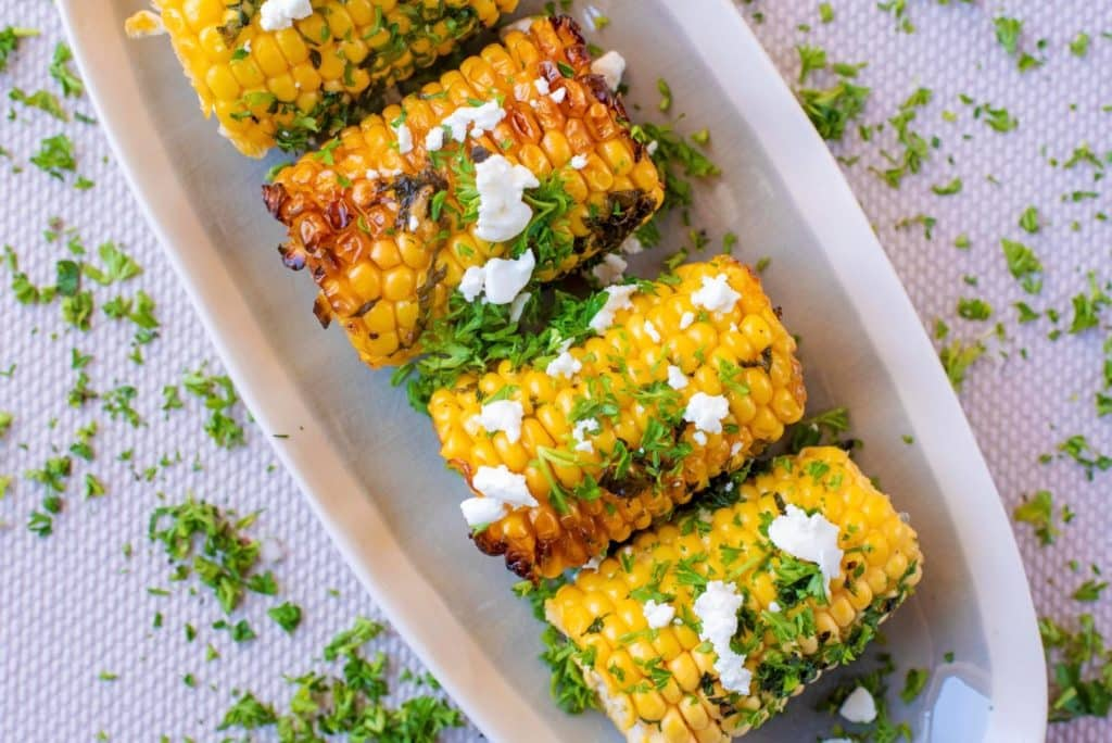 Horizontal shot of Grilled Corn with Herb Butter