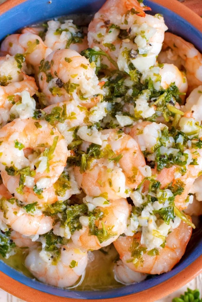 Very close up shot of Lemon, Garlic and Herb Prawns