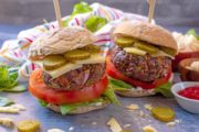 Hidden Vegetable Beef Burgers in buns with skewers through them