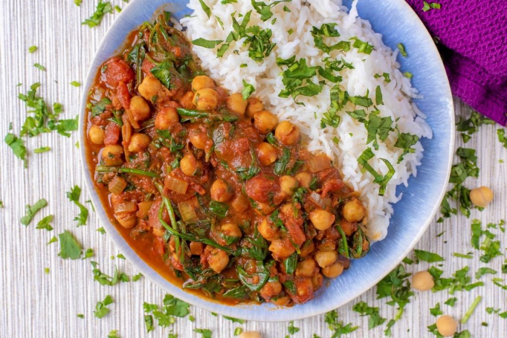 A plate of chickpea curry and rice on a plate
