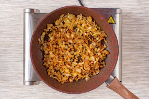 chopped onions and spiced cooking in a frying pan