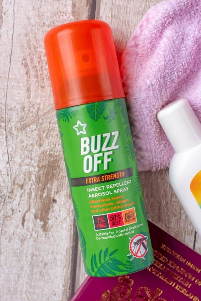 A green aerosol can of insect repellent