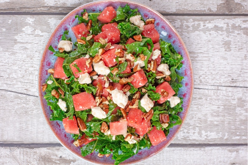 A plate of kale, watermelon and feta salad