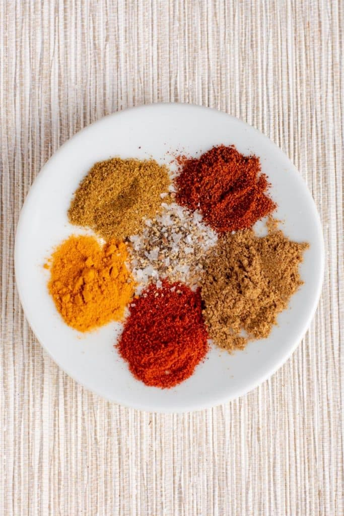 Selection of spices on a white plate