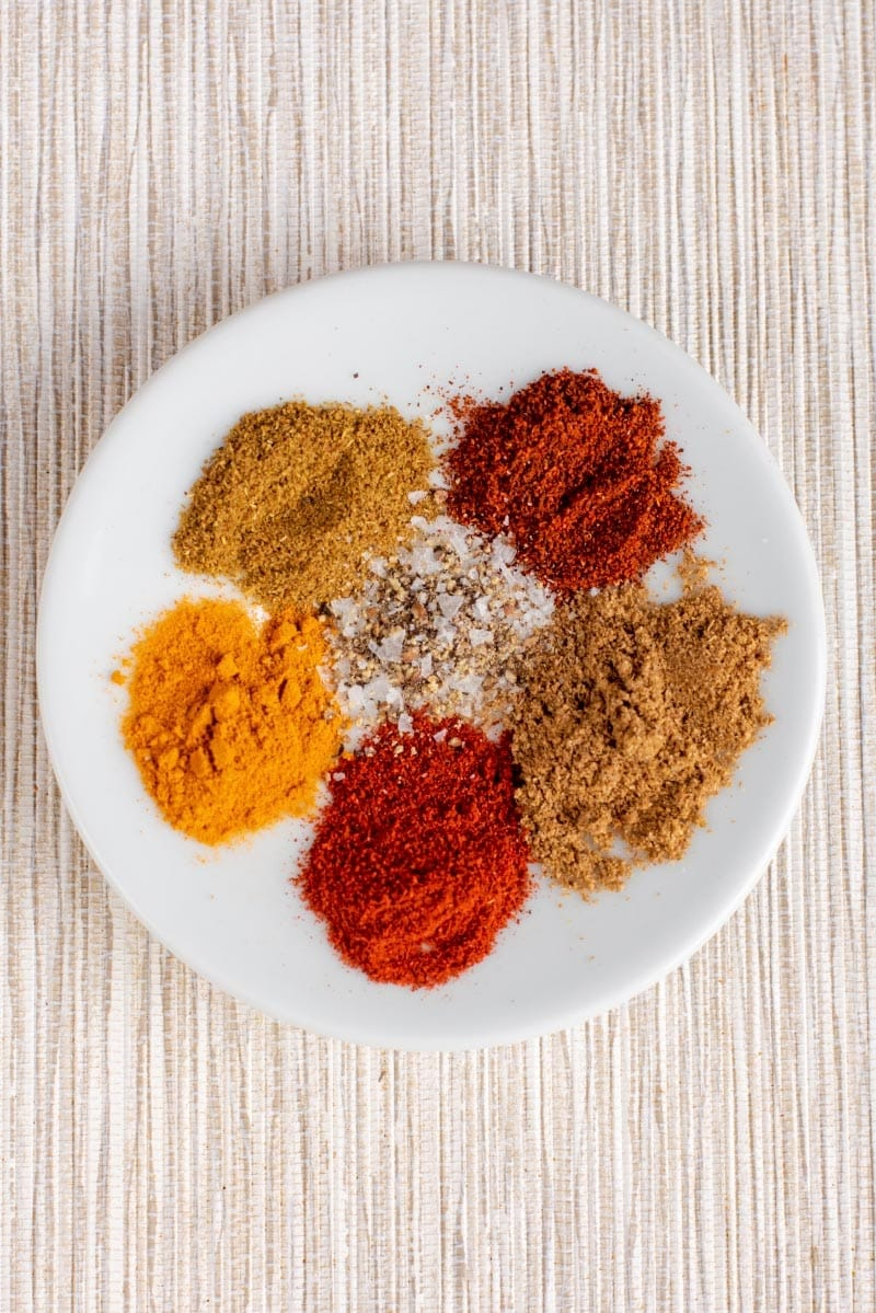Selection of ground spices on a white plate
