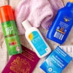 Soleve Sunburn relief, insect repellent, paracetamol, passport and pink wash cloth