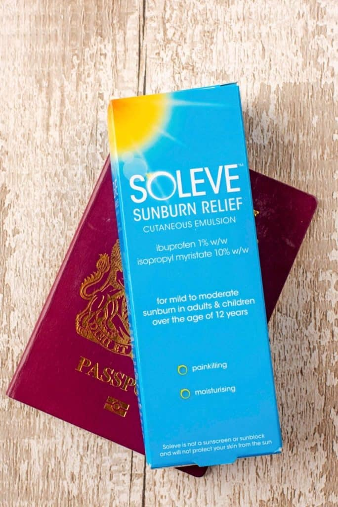 A box of Soleve sunburn relief sat on a passport