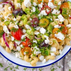 Pasta salad in a blue and white bowl