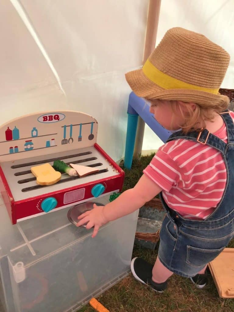 a child playing with a toy oven