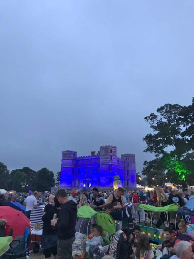 A castle lit up with blue lights