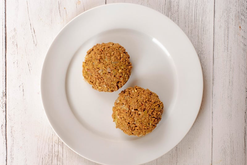two meat free quorn burgers on a white plate