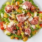 Italian Chopped Salad with Parma Ham in a large white bowl