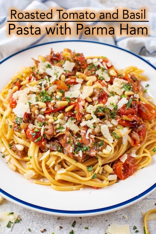 Sweet and juicy roasted tomatoes stirred through garlic herb spaghetti and mixed with Parma Ham is such a simple and classic pasta dish. Roast the tomatoes ahead of time and then heat them up with the spaghetti when you are ready to eat it - thispasta with tomatoes and basil is an easy weeknight meal. #pasta #parmaham #italian