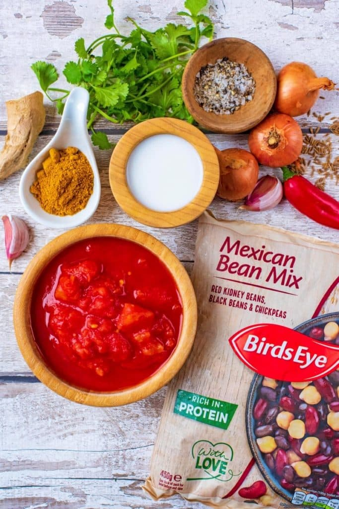 A bag of BirdsEye three bean mix with chopped tomatoes, shallots, herbs and spices