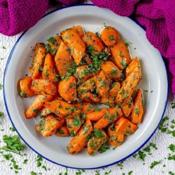 Garlic and Parsley Roasted Carrots in a white bowl.