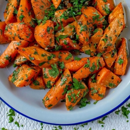 Garlic and Parsley Roasted Carrots in a white bowl