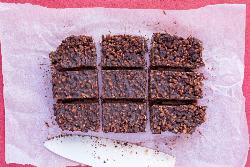 A chilled chocolate rice cereal slab cut into nine bars